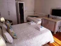 Pool Area Queen and 2 Single Beds Room
