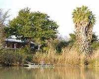 Brownhooded River Cottage
