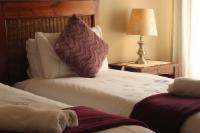 [2] Twin beds en-suite