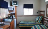 Kamer 6 / Room 6 (Kiepersol)